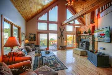 Pinecone Manor Living Room featuring Wall of Windows