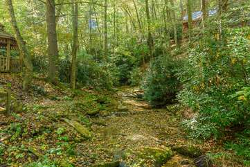 Timber Creek offers Wooded Acreage with a Creek and Fire Pit, and Walking Trails