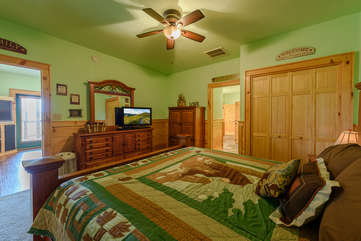 Downstairs Bedroom with King Bed, adjoining Bathroom with Sauna