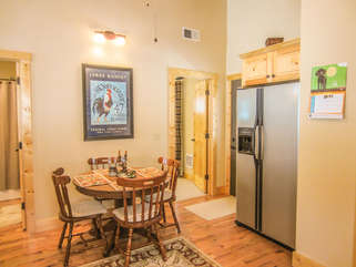 Bear Tracks Cabin Dining Area with Stainless Fridge in Kitchen