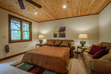 Downstairs Living Room easily converts to private bedroom suite