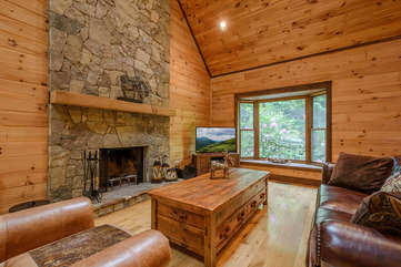 Kingfisher Living Room with wood-burning fireplace, large TV