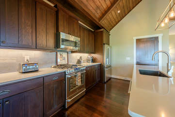 Kitchen with Custom Cabinets and Quartz Counters