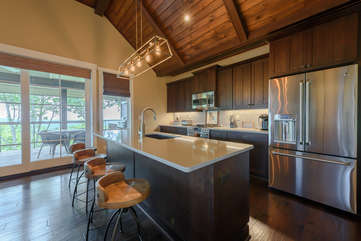 Custom Kitchen with Stainless Steel Appliances and Center Island