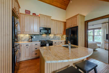 Carriage House Kitchen with Granite Countertops and Dining Island