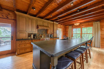 Leathered Granite Island in Kitchen with Seating for Four