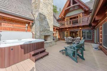 Outdoor Stone Wood-Burning Fireplace on Deck