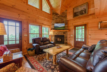 Living Area with Leather Couches, Stone Fireplace, HDTV