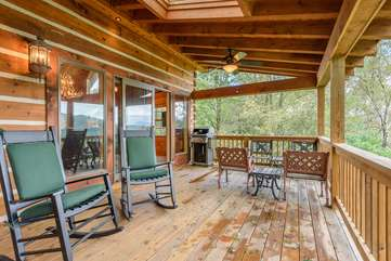 Large Rear Covered Deck features Rocking Chairs and Four Conversational Chairs with Side Tables