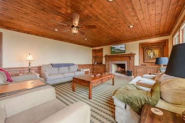 Comfortable Furniture and Wood-Burning Fireplace in Living Room