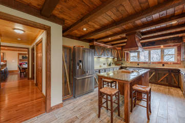 Custom Kitchen with Stainless Appliances and Granite Island