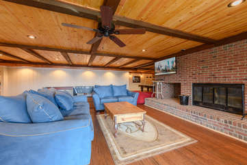 Downstairs Den with Fireplace and Huge HD Smart TV
