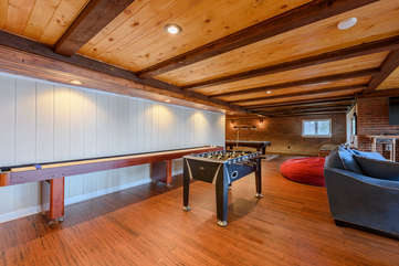 Shuffleboard and Foosball Tables in Den and Game Room