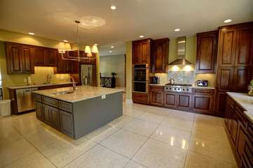 Central Kitchen with Granite Countertops and High End Stainless Appliances