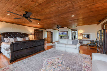 King Master Suite with Huge HD Smart TV and Comfy Sitting Area