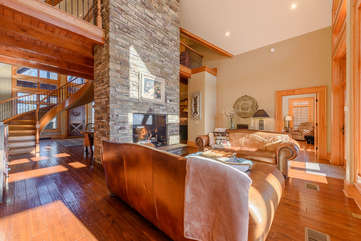 Phoenix Mountain Lodge Living Room with Leather Sofas and Stone Fireplace