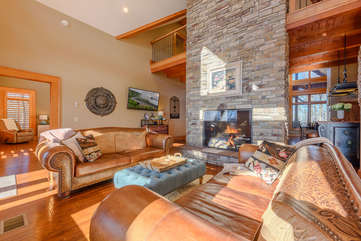 Main Level Living Room with Leather Sofas, Stone Fireplace, TV