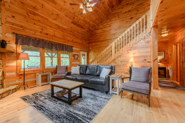 Living Room With Comfy Seating and Rustic Wood Walls