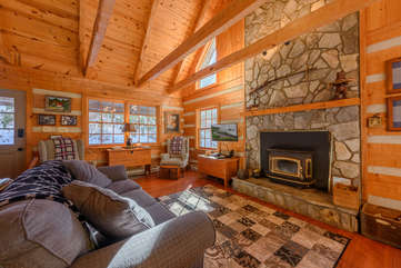 Living Area with Wood-Burning Fireplace and TV