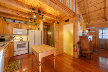 Martin's Nest Kitchen with Hallway to Main Level Bedroom, Stairs Accessing Lower Level