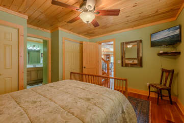 Queen bedroom on main level with TV, shared bathroom