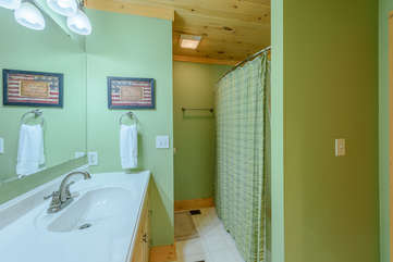 Bathroom with tub/shower shared by main level king and queen bedrooms