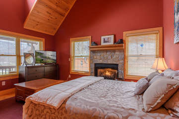 King bedroom on Main Level with fireplace, outdoor access, shared bathroom