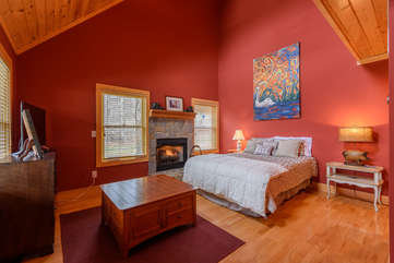 Large King bedroom on Main Level with fireplace, TV, shared bathroom