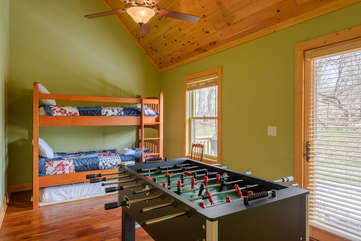 Bunk room on Main Level with access to back deck, TV, foosball table