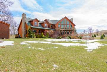 Camelot Lodge with large yard bordering pasture land offers privacy, room for children and pets to play