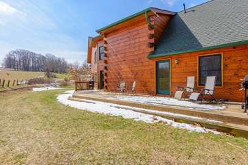 Camelot Lodge Back Deck with gas grill, lots of privacy and beautiful view of rolling pasture land behind home