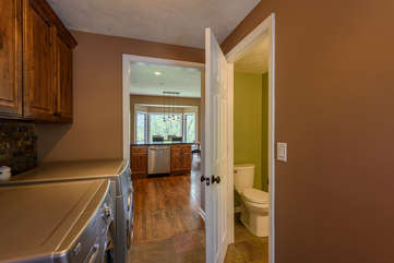 Large laundry room with extra half-bath next to kitchen