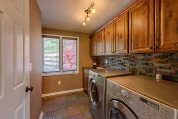 Large laundry room with utility sink, half-bath