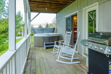 Covered porch with hot tub, grill, rocking chairs