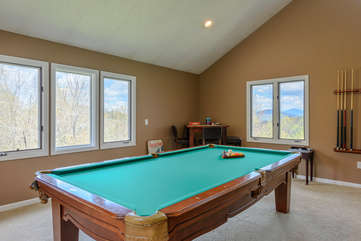 Pool table and game room with views on upper level at Flat Top Lodge