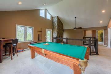Pool table and game room in upper level of Flat Top Lodge