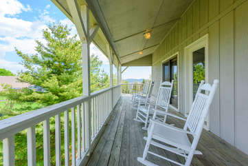 Upper level porch with rocking chairs, beautiful views