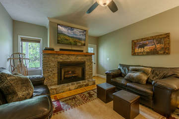 Lower level living area with gas log fireplace, TV, comfortable seating