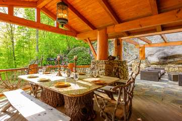 Covered Outdoor Dining With Granite Table and Authentic Log Slab Seating