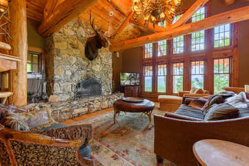 The Rock Living Area with stone wood-burning fireplace, comfortable seating, mountain views