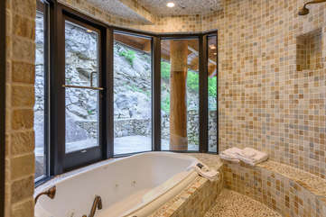 Large walk-in tiled shower and jetted tub in Master Bathroom on main level