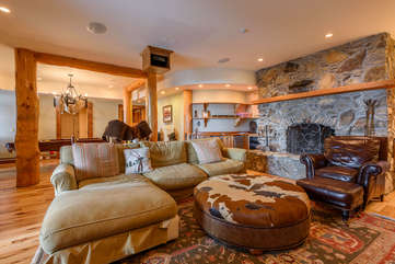 Theatre Area with Lots of Comfortable Seating and a Fireplace