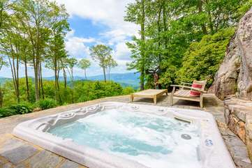 Hot Tub set into patio with teak wood lounge chairs, amazing view
