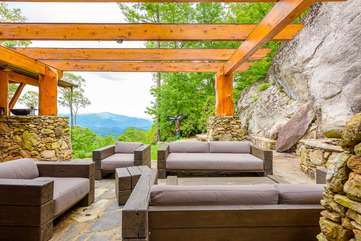 Comfortable seating on stone patio at the Rock