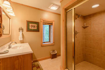 Downstairs bathroom with large walk-in tiled shower