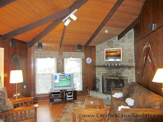 Village Creek Living Room with wood burning fireplace