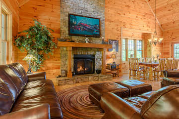 Cozy Living Room with gas log fireplace, TV