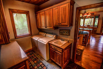 Tyneloch washer/dryer combo located to right of kitchen