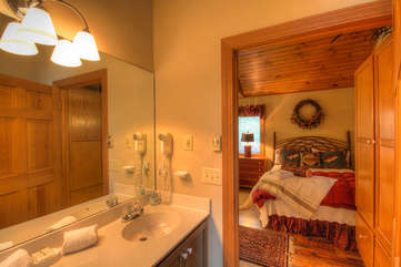 Tuscarora Cottage Large Bathroom with Double Vanity, Jetted Tub, Shower, and Skylight