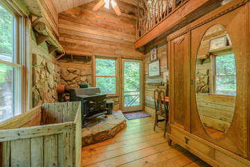 Mud Room entrance on side of house with large woodstove, loft above
